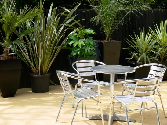 63Pool garden - c:up of table:chairs